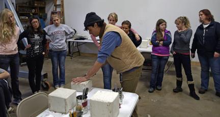 Artist Peter Morales teaching plaster carving techniques to RAP participants.