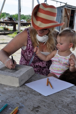 A mother and daughter work on their scratch mold at Saturday's workshop.