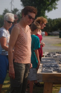A community member admires finished products from last year's pour.