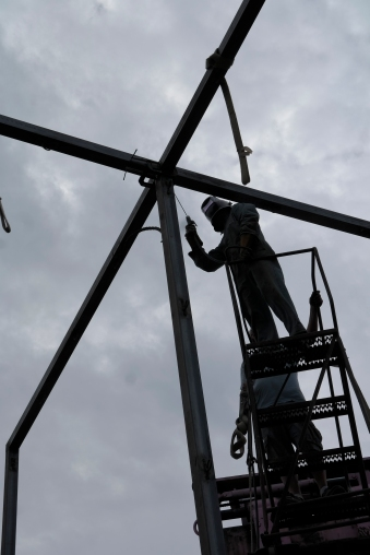 To weld the last piece of her frame structure, Klemperer had to be lifted 25 feet into the air.